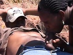 African teenagers deep throating on stiff boners outdoors