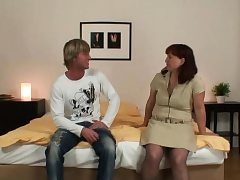 Red-haired old woman in pantyhose rides him