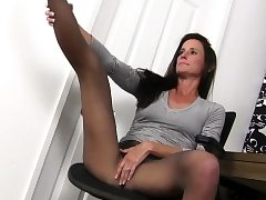 American milf Joclyn takes care of her pantyhosed honeypot