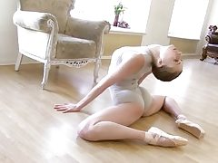 Gymnastic youthfull shorthaired babe displays skills