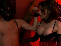 Sexy honey dressed in a slutty corset and sexually manhandling her slave