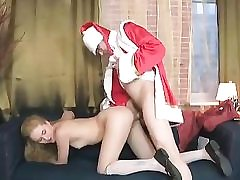 Ash-blonde ultra-cutie is blowing this insane Santa's huge pecker deep throat