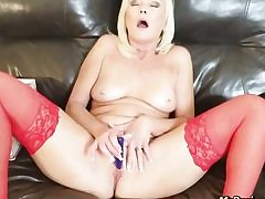 Super-steamy towheaded wearing red latex tugging her pussy hole all alone