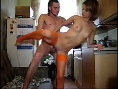 Teenage in orange nylons takes boner